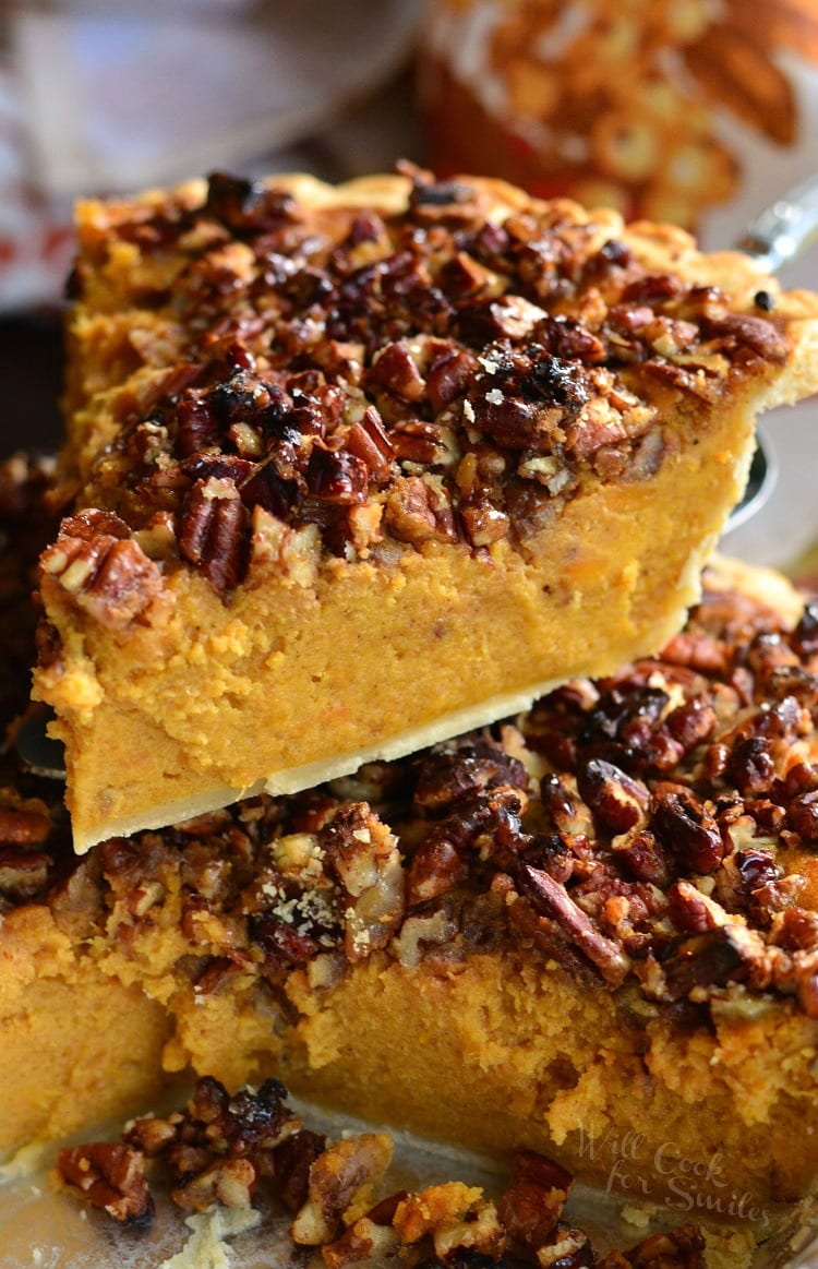 Pecan Crunch Sweet Potato Pie being lifted out of the pie pan