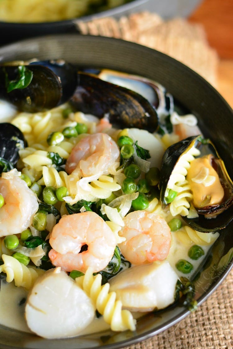 Creamy Spinach and Peas Seafood Pasta in a pan
