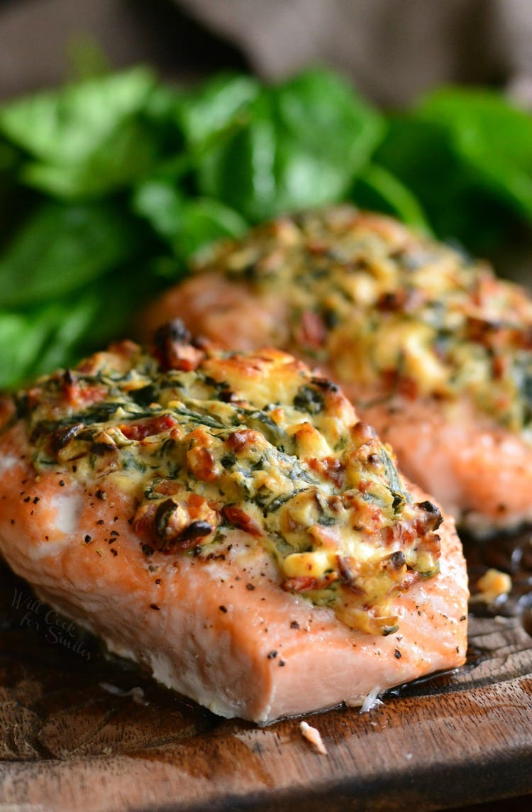 Creamy Spinach and Sun Dried Tomato Stuffed Salmon on a wood cutting board