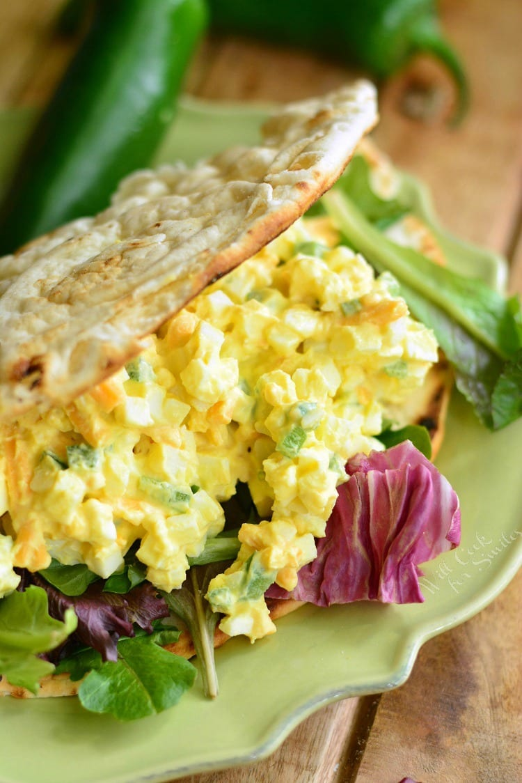 Jalapeno Cheddar Egg Salad in a pita on a plate