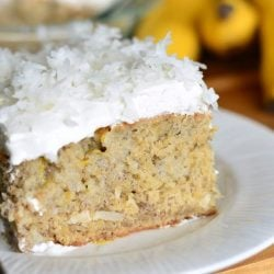 1 slice of lemon coconut banana cake on a white plate as viewed close up