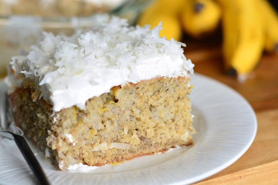 Lemon Coconut Banana Poke Cake on a plate with a fork