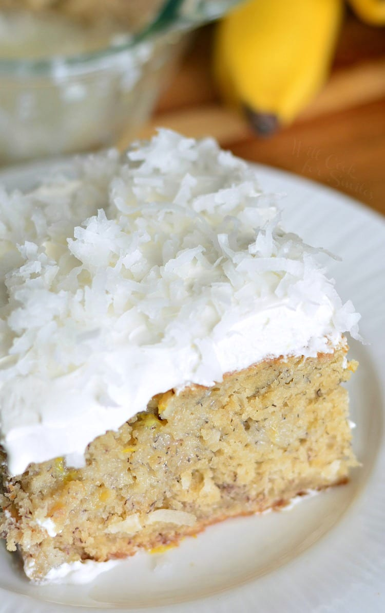 Lemon Coconut Banana Poke Cake on a plate