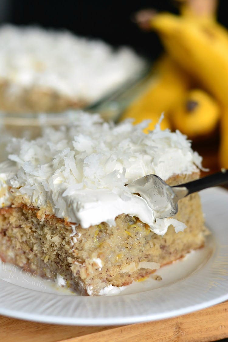 Lemon Coconut Banana Poke Cake with a fork