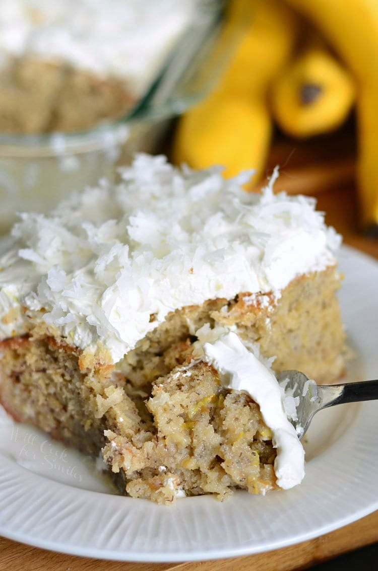 Lemon Coconut Banana Poke Cake in on a plate with a fork