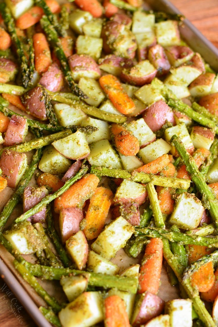 Pesto Roasted Potatoes Carrots and Asparagus. Potatoes, asparagus, and carrots are simply tossed in homemade cashew pesto and roasted in the oven. #pesto #veggies #sidedish #roastedvegetables