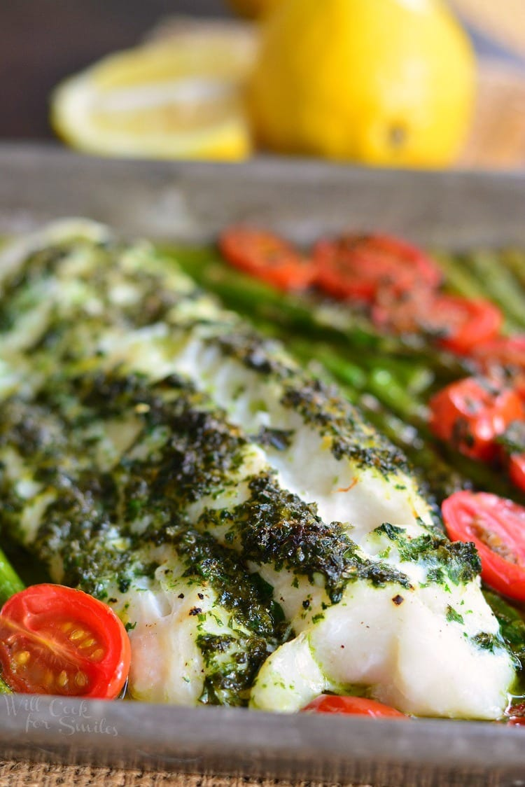 Lemon Herb Butter Cod with Asparagus and Tomatoes in a baking dish