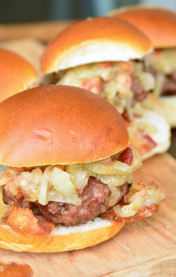 Bacon Burger Sliders with Bacon Caramelized Onions. This is a simple bacon burger recipe that combines finely ground bacon with ground beef to create a juicy, bacon infused hamburger. #bacon #burger #grill #bbq #potluck #baconburger #sliders