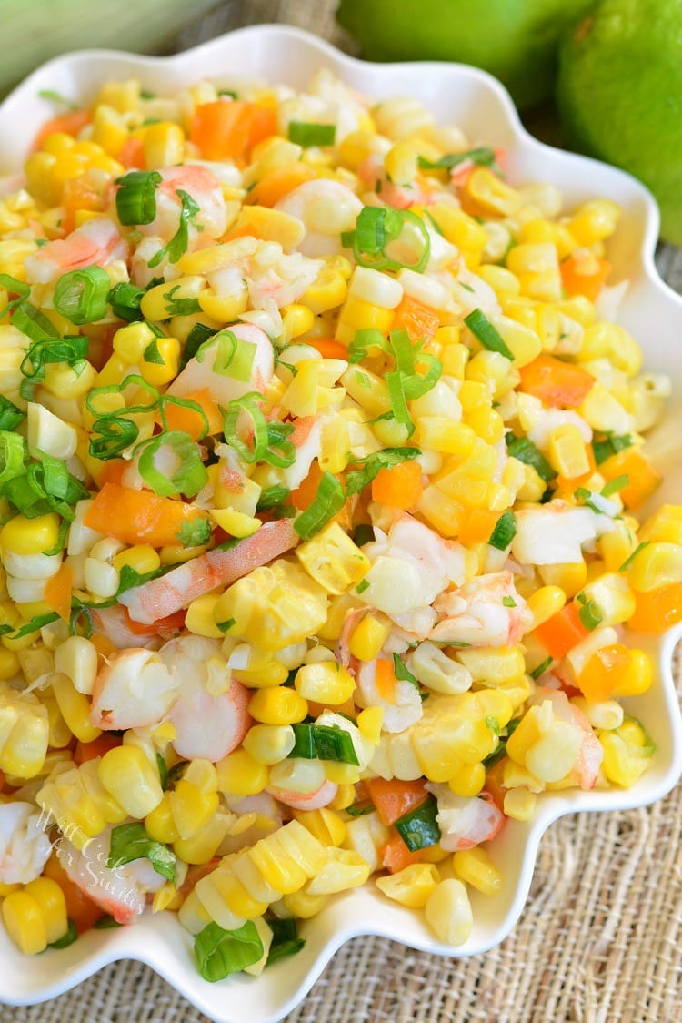 Cilantro Lime Shrimp Corn Salad. Wonderful corn salad made with shrimp, sweet bell peppers, shallots, and fresh cilantro and lime flavors. It can be simply cooked on stove top or the grill. #cornsalad #shrimp #sidedish #salad #corn #bbq #cookout #potluck