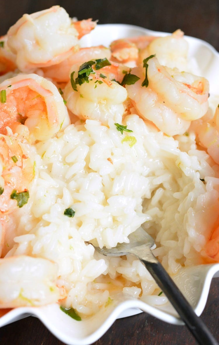 Key Lime Coconut Shrimp and Coconut Rice recipe. Fresh shrimp is sauteed in coconut milk and lime sauce and serve on the bed of sticky coconut rice. Easy 30-minute dish and only a few simple ingredients to create this delicious tropical dinner. #shrimp #coconutshrimp #rice #coconutrice #easydinner #seafoodrecipes