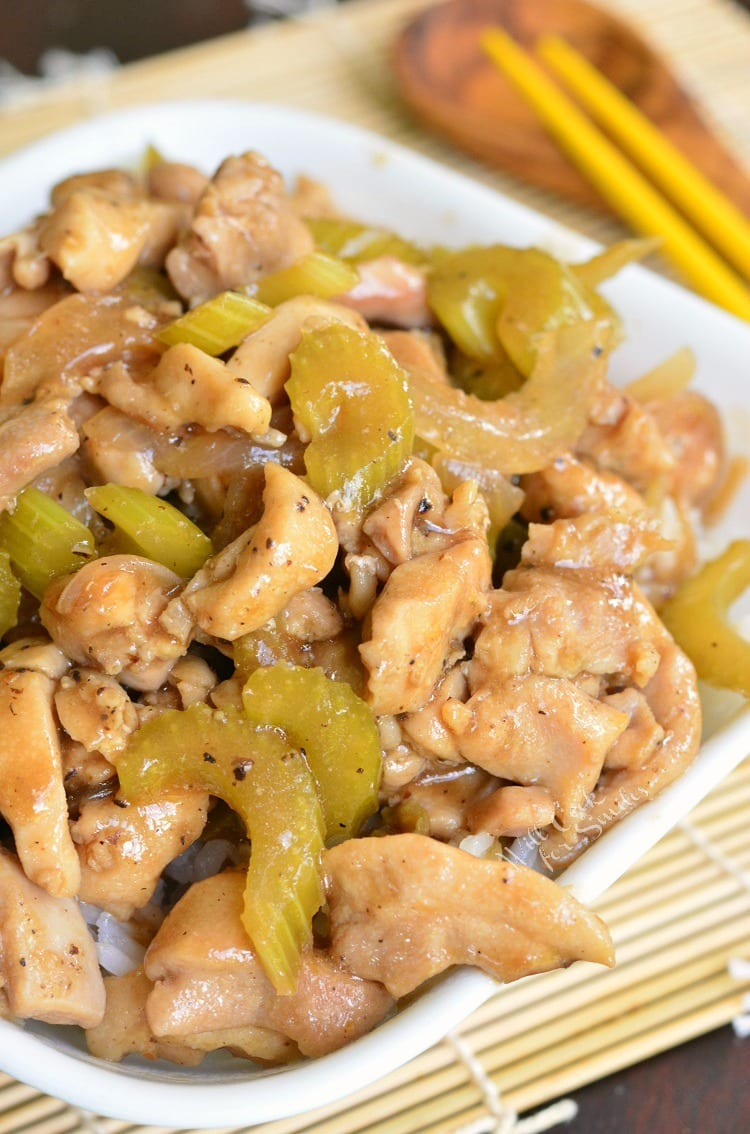 Copycat Pepper Chicken and Rice recipe. Once you try this homemade version of Panda Express Pepper Chicken, you'll never go back to take-out. Juicy, tender chicken thigh meat is sauteed with onions and celery and cooked in black pepper soy sauce. Easy and delicious 30-minutes dinner. #chicken #chickenthighs #rice #chickenandrice #easydinner