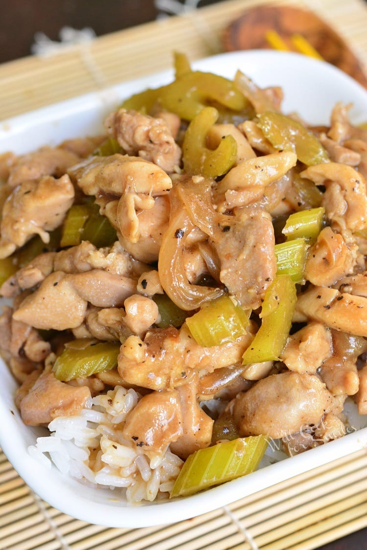 rice topped with cooked chicken, celery, and onions