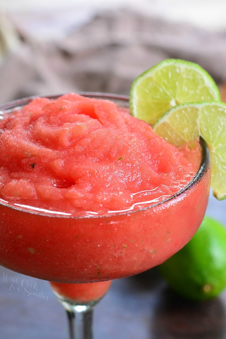 Watermelon Lime Frozen Margaritas in a glass with lime garnish