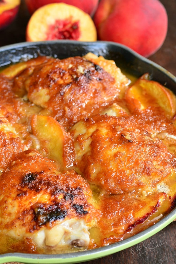 Baked Ginger Peach Chicken. These baked chicken thighs are cooked with fresh peaches, shallots, and ginger peach puree. Slightly sweet peach flavors come through subtly in this chicken dish, without overwhelming any other flavors, and pairs wonderfully with fresh ginger. #chicken #dinner #peach #recipe #ginger #rice