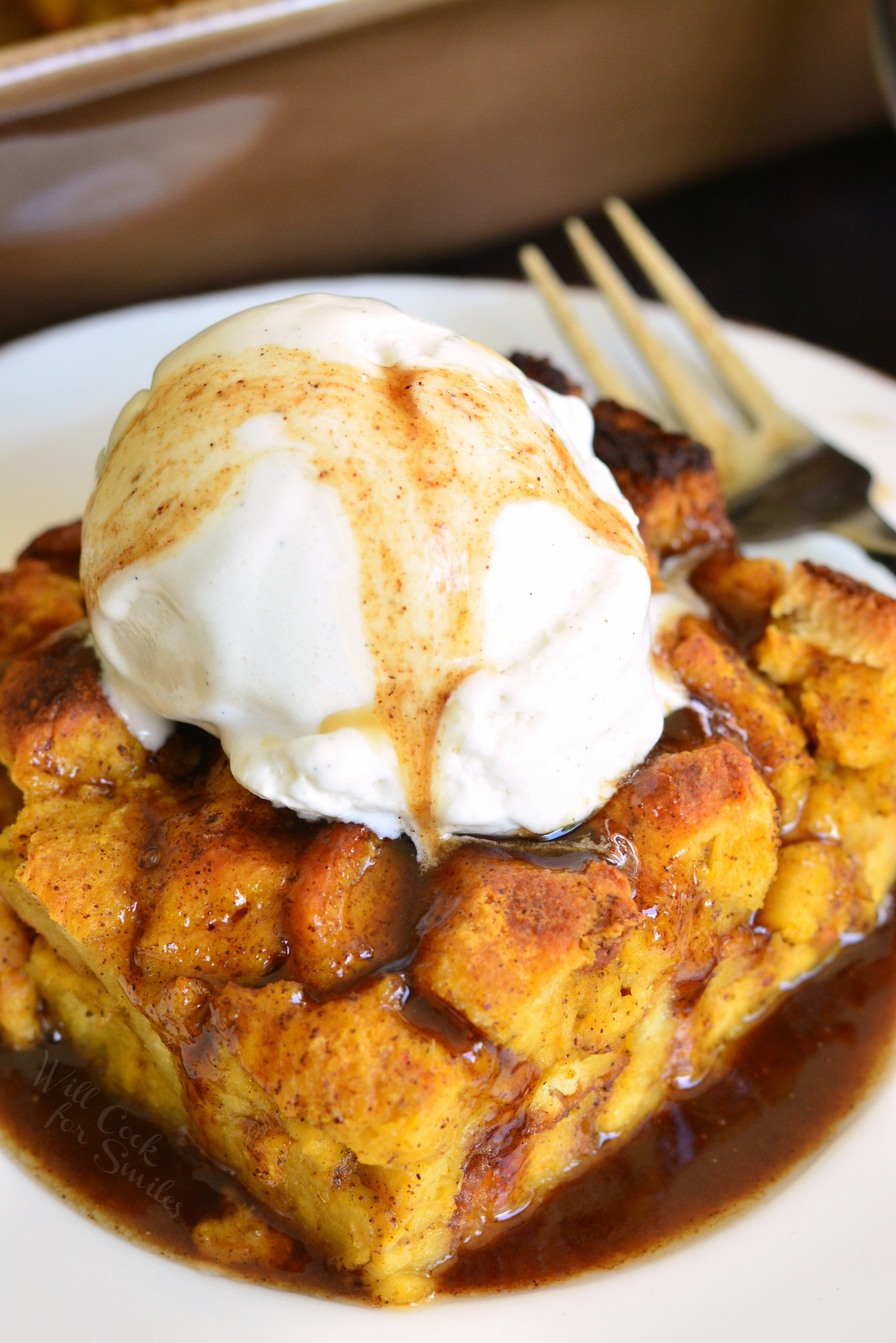 Brioche Pumpkin Bread Pudding. This bread pudding is a comforting fall dessert made with soft and tender Brioche bread. Pumpkin pie and bread pudding came together here to create one luscious dessert recipe. This pumpkin bread pudding is also topped with an easy Butter Rum Sauce and ice cream. #pumpkin #breadpudding #falldessert #sauce #butterrum #dessert