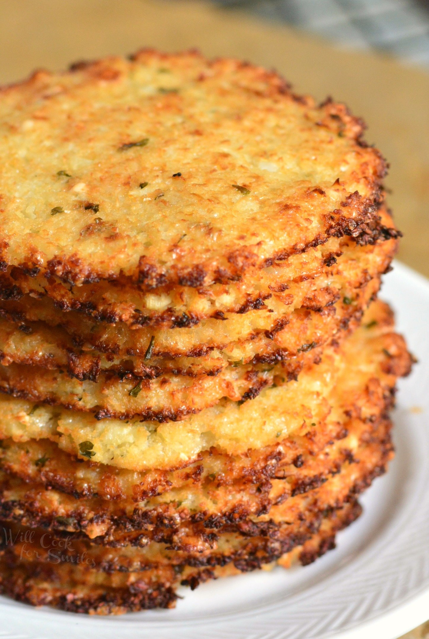 Cauliflower Parmesan Crisps. Amazing cauliflower snack that kids and adult will love. All you need is a head of cauliflower, block of Parmesan cheese, dry parsley flakes, and some garlic powder. #snack #cauliflower #parmesan