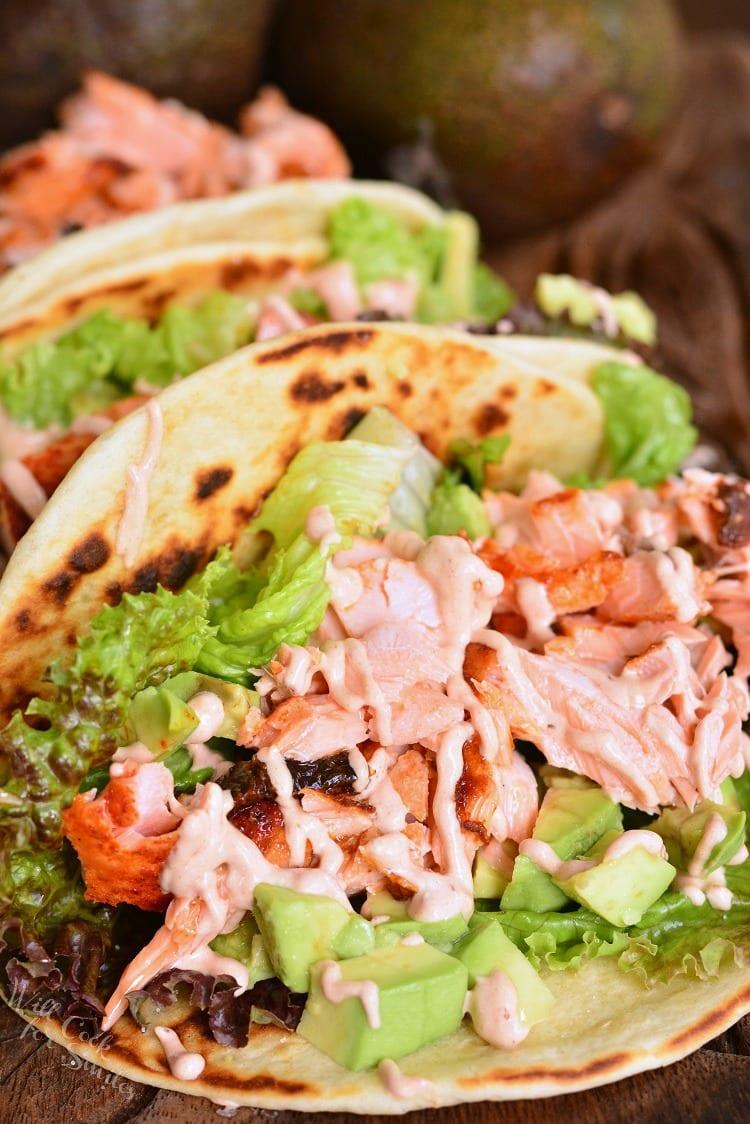 salmon tacos on a cutting board
