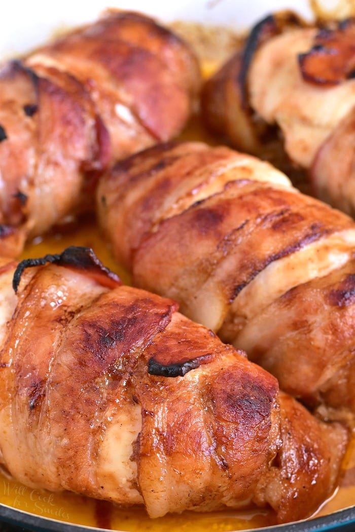 Bacon Wrapped BBQ Stuffed Chicken Breasts recipe. Only 4 ingredients to created this delicious chicken dinner. Inside, this chicken is stuffed with a mixture of onions sauteed with bacon and BBQ sauce and outside, the chicken is slathered with more BBQ sauce and wrapped in bacon. #chicken #bbq #bacon #baconwrapped #bakedchicken
