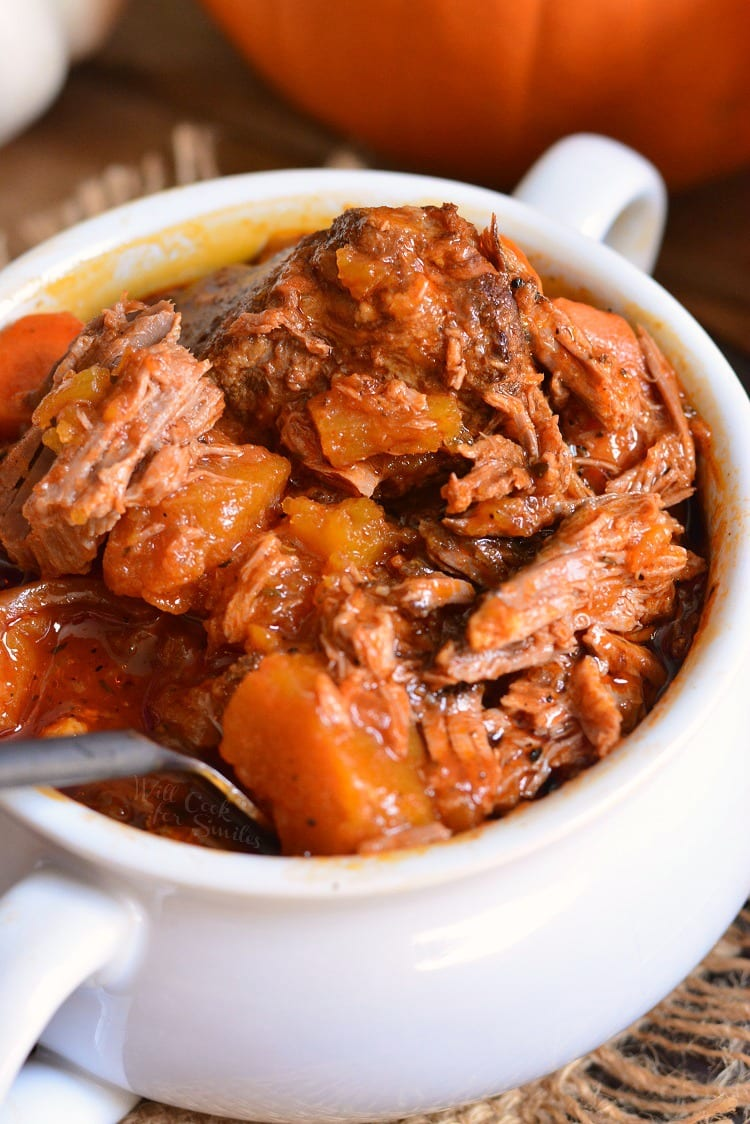 Crock Pot Roast with pumpkin is a perfect seasonal twist on on a classic comfort dinner. Tender roast made in a slow cooker with fresh pumpkin, carrots, onions, and flavorful tomato based gravy. #potroast #crockpot #slowcooker #crockpotroast #pumpkin #beef
