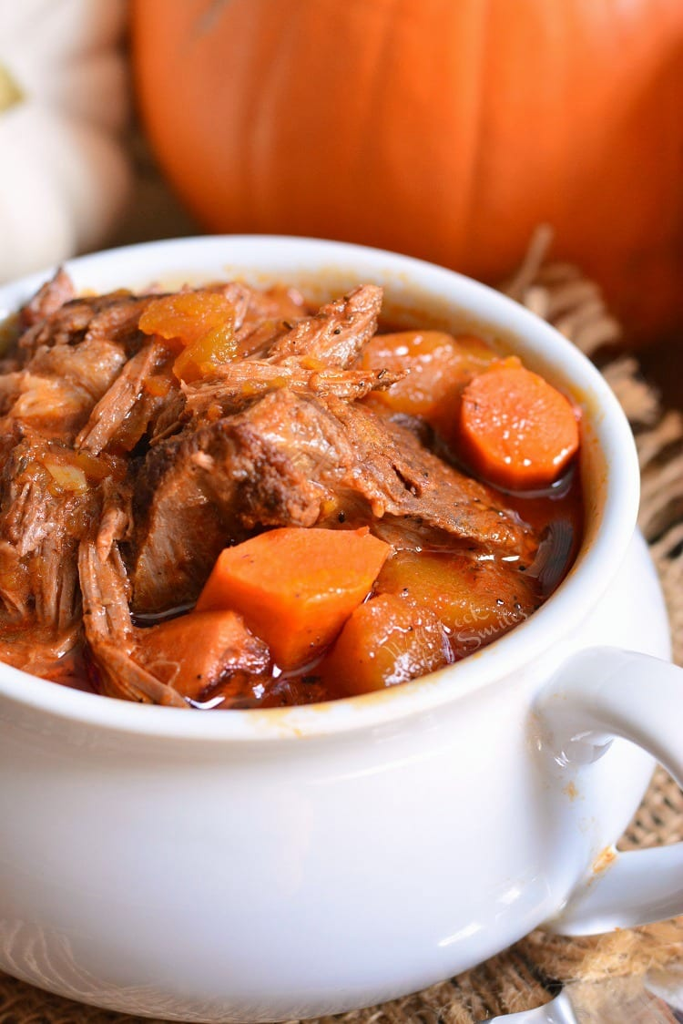 Pot Roast in a Crock Pot made with pumpkin. It's a perfect seasonal twist on on a classic comfort dinner. Tender roast made in a slow cooker with fresh pumpkin, carrots, onions, and flavorful tomato based gravy. #potroast #crockpot #slowcooker #crockpotroast #pumpkin #beef
