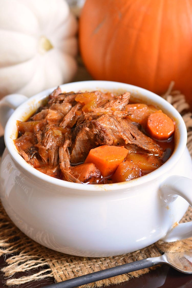 Crock Pot Roast Recipe is a perfect seasonal twist on on a classic comfort dinner. Tender roast made in a slow cooker with fresh pumpkin, carrots, onions, and flavorful tomato based gravy. #potroast #crockpot #slowcooker #crockpotroast #pumpkin #beef