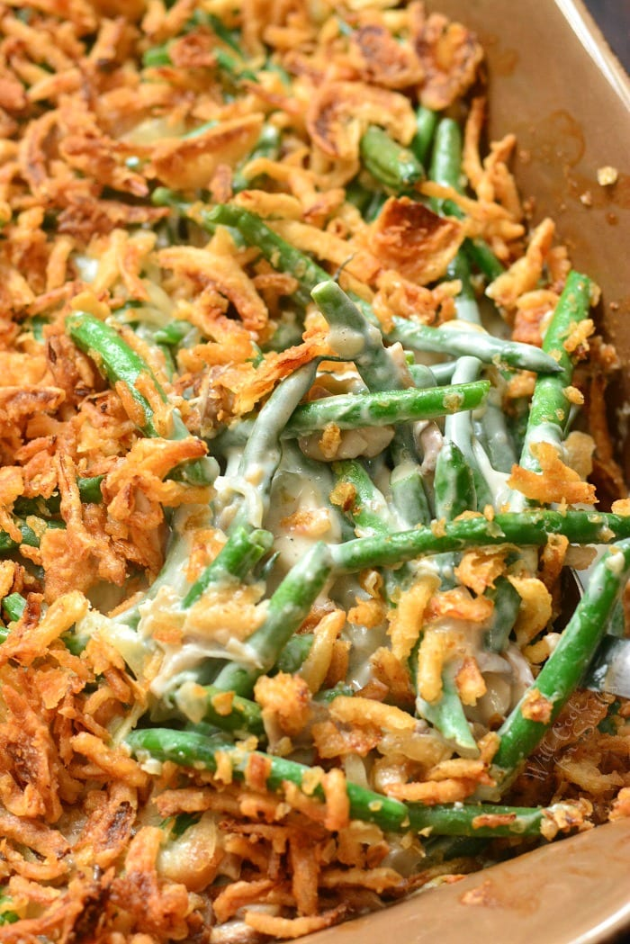 Green Bean Casserole is a classic holiday side dish. This casserole is made with fresh green beans, creamy mushrooms sauce, and French's fried onions. #greenbeans #casserole #sidedish #sides