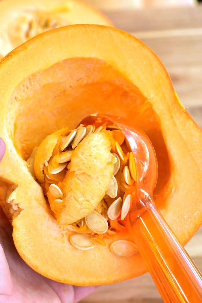 How to cup pumpkin. Scoop out seeds and membrane.