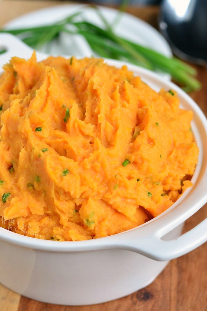 Mashed Sweet Potatoes. These mashed sweet potatoes are not too sweet and perfectly compliment any main dish. Rich and creamy made with butter, sour cream, and chives. #sweetpotatoes #bakedsweetpotatoes #instantpotsweetpotatoes #crockpotsweetpotatoes #sidedish