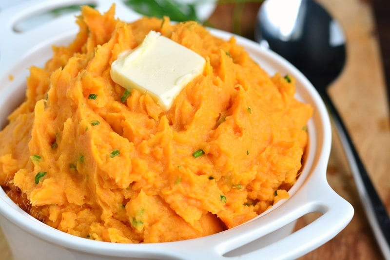 Sweet Potatoes. These mashed sweet potatoes are not too sweet and perfectly compliment any main dish. Rich and creamy made with butter, sour cream, and chives. #sweetpotatoes #bakedsweetpotatoes #instantpotsweetpotatoes #crockpotsweetpotatoes #sidedish