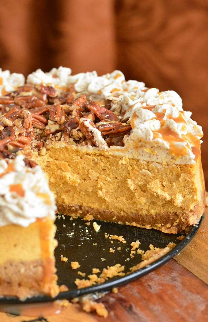Pumpkin Cheesecake with Pecans and Caramel on a table