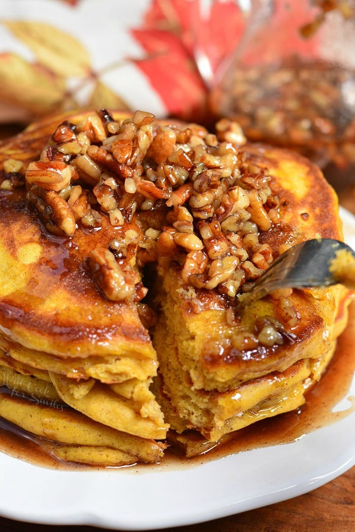 Soft and Fluffy Pumpkin Pancakes with Cinnamon Pecan Syrup. These soft, fluffy buttermilk pancakes are made with pumpkin puree and spices. Over the top of these easy pumpkin pancakes is a simple Cinnamon Pecan Syrup. #pancakes #breakfast #pumpkin #pumpkinpancakes #syrup #fallrecipes #fallbreakfast