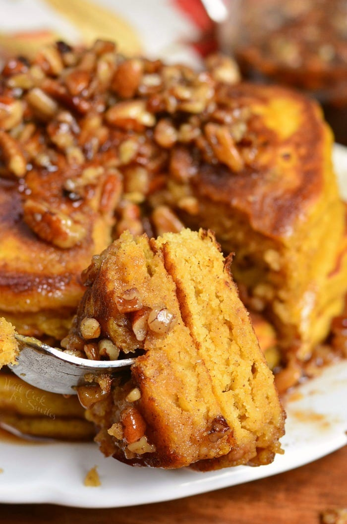 Homemade Pumpkin Pancakes with Cinnamon Pecan Syrup. These soft, fluffy buttermilk pancakes are made with pumpkin puree and spices. Over the top of these easy pumpkin pancakes is a simple Cinnamon Pecan Syrup. #pancakes #breakfast #pumpkin #pumpkinpancakes #syrup #fallrecipes #fallbreakfast
