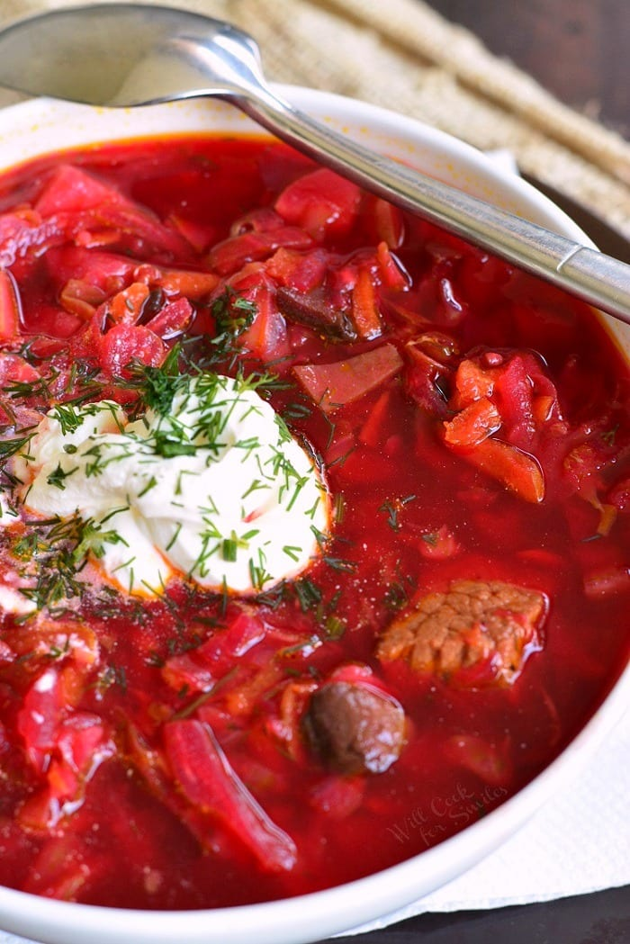 Russian Borscht Soup. This classic Russian Borscht recipe is healthy, nutritious, and comforting soup for colder season. Traditional Russian beet soup made with cabbage, beef, and many other vegetables. #soup #cabbagesoup #beefsoup #borscht #russiansoup #russianrecipes
