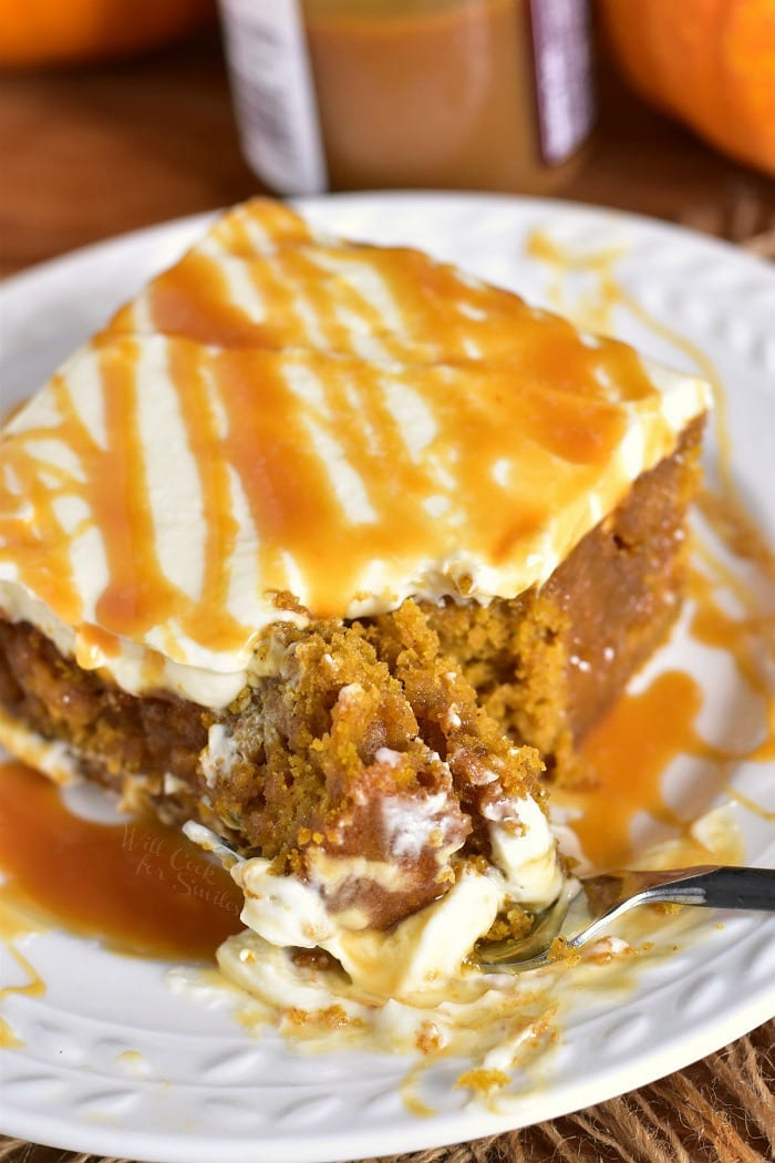 Pumpkin Cake with Salted Caramel and Cream Cheese Frosting. Soft, moist pumpkin cake soaked with salted caramel and topped with smooth cream cheese frosting. This pumpkin cake is paired beautifully with salted caramel flavors and creamy frosting in each bite. #cake #Pumpkin #pumpkincake #caramelcake #saltedcaramel
