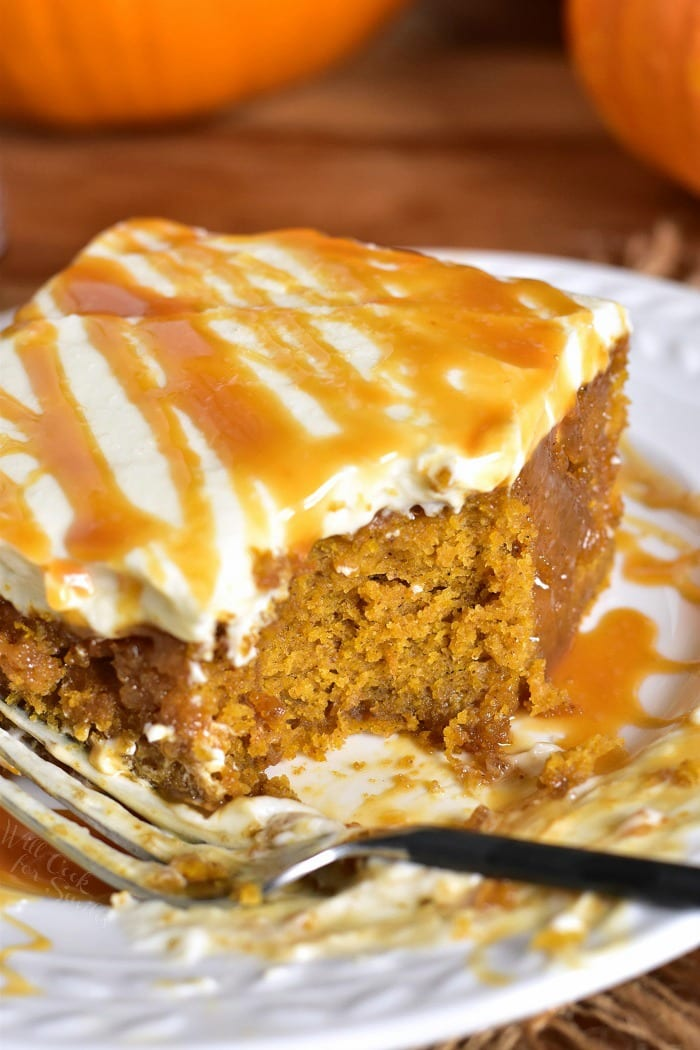 Salted Caramel Pumpkin Cake with Cream Cheese Frosting. Soft, moist pumpkin cake soaked with salted caramel and topped with smooth cream cheese frosting. This pumpkin cake is paired beautifully with salted caramel flavors and creamy frosting in each bite. #cake #Pumpkin #pumpkincake #caramelcake #saltedcaramel