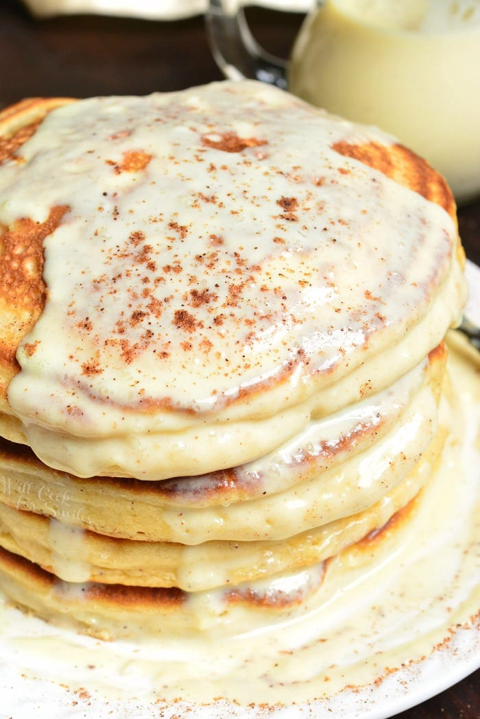 Eggnog Pancakes staked on a plate with eggnog sauce