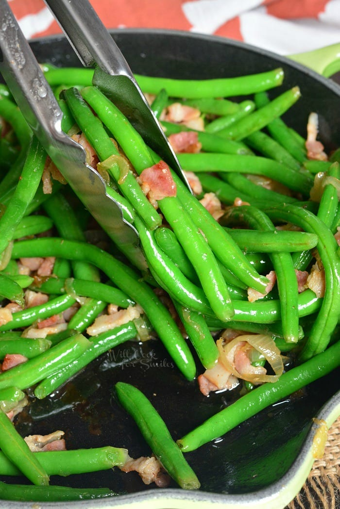Fresh Green Beans with Bacon and Onion. Fresh green beans make a wonderfully easy side dish to any meal. These green beans are blanched and sauteed with bacon and onions. #sidedish #greenbeans #bacon #sides