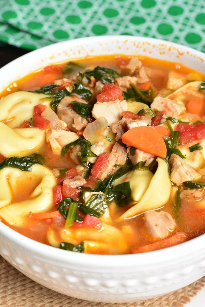 Leftover Turkey Tortellini Soup. This tomato based soup is an easy, 30-minute soup loaded with veggies, turkey, and cheese tortellini. #turkey #leftovers #tortellini #soup #leftoverturkey