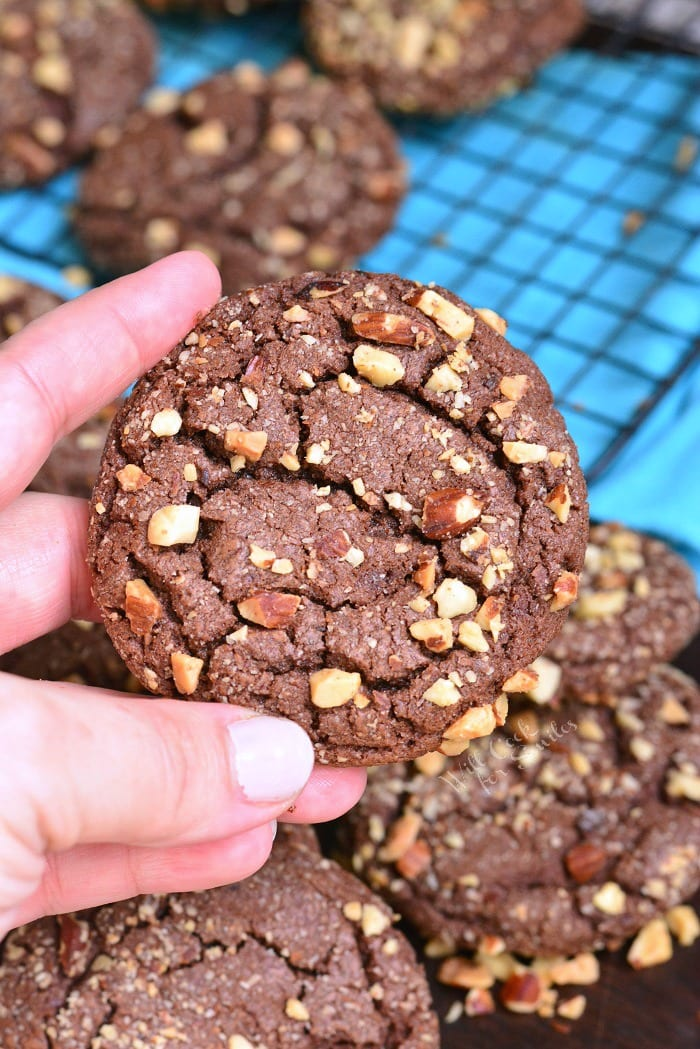 Nutella Chocolate Cookies are soft in the middle and crunchy on the outside. These chocolate cookies are loaded with Nutella spread in the dough and coated with crunchy nut pieces. #cookies #chocolatecookies #Nutella #dessert