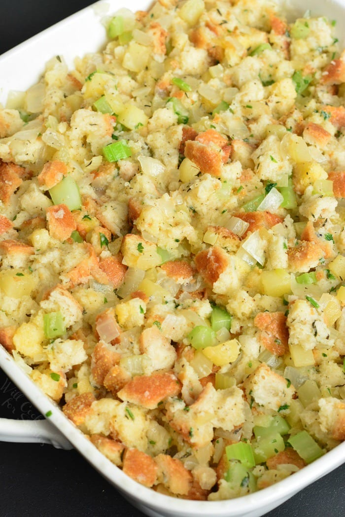 Homemade Stuffing Recipe. This stuffing is made with Italian bread, apples, celery, onions, and herbs. #sidedish #stuffing #bread #thanskgiving #dinner #sides