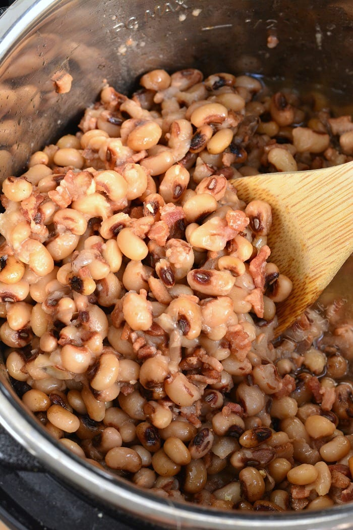 Black Eyed Peas in Instant Pot with wooden spoon