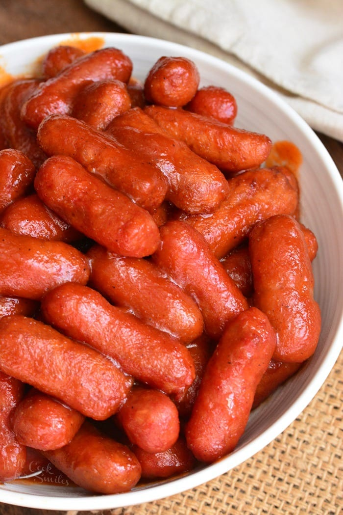 BBQ Little Smokies. Little Smokies with BBQ Sauce. These little sausages are to tasty and simple cooked in a homemade BBQ sauce. Make it quickly and easily on stove-top or in a crock pot. #appetizer #sausage #littlemsmokies #bbq #bbqsauce