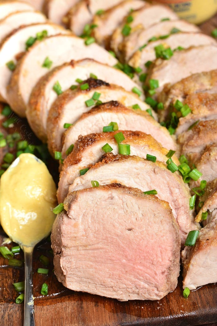 Pork Tenderloin. This pork tenderloin is rubbed with a flavorful mixture of Dijon mustard, brown sugar, and spices. It's prepared in the oven and ready in just 30 minutes. #pork #porktenderloin #dijon #maindish #dinner
