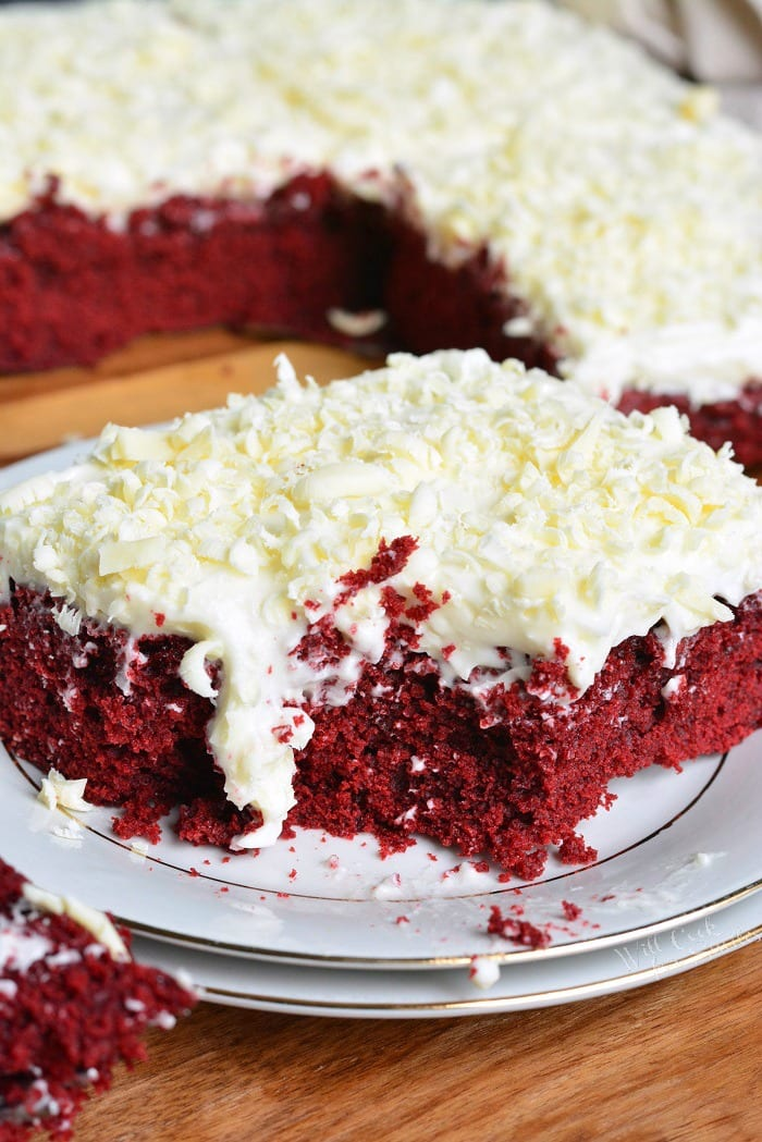 Red Velvet Brownies. Beautiful, chewy red velvet brownies topped with white chocolate cream cheese frosting and white chocolate shavings. #brownies #dessert #redvelvet #frosting #creamcheesefrosting #whitechocolate