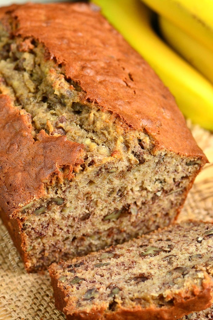 Banana Bread with a slice cut off on a burlap table cloth