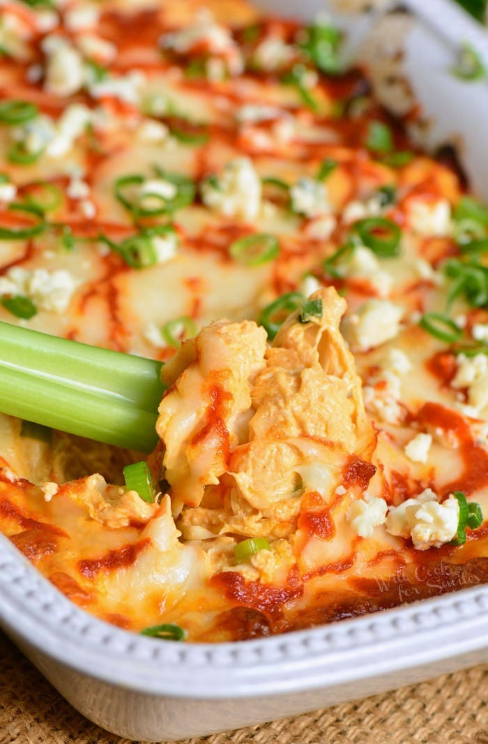 Buffalo Chicken Dip is a perfect party dip made withchicken meat cooked in buffalo wing sauce, cream cheese, Monterrey Jack cheese, and Blue cheese crumbles. #dip #chickendip #appetizer #partyfood #buffalochicken