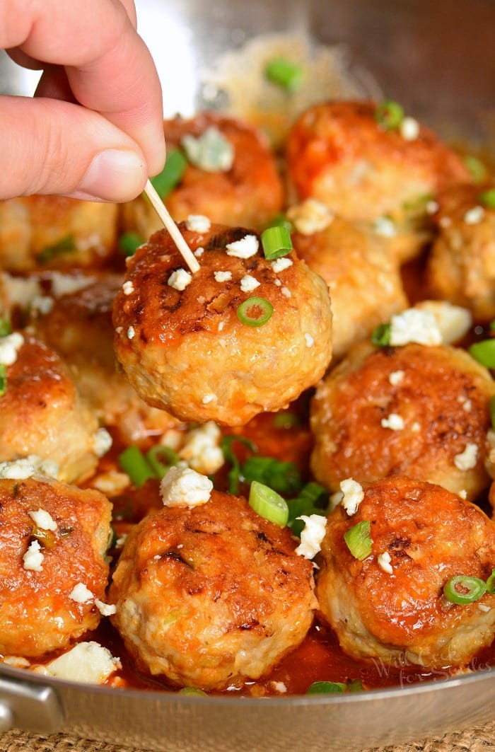 Buffalo meatballs with blue cheese with toothpick going into one