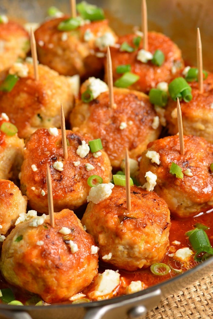 Buffalo Chicken Meatballs in a pan with toothpicks