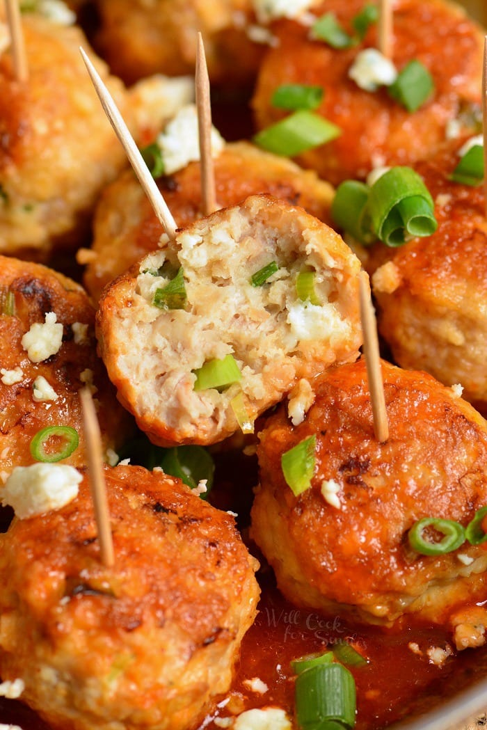 Buffalo meatballs with blue cheese with toothpicks in them