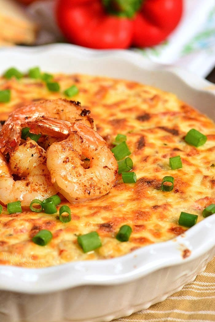 Cajun Shrimp Dip is a delicious hot appetizer perfect to serve for any occasion. It's loaded with shrimp, cheese, veggies, and Cajun spices all combined into an amazing spicy hot dip. #dip #shrimp #cheesedip #seafood #shrimpdip #cajunshrimp
